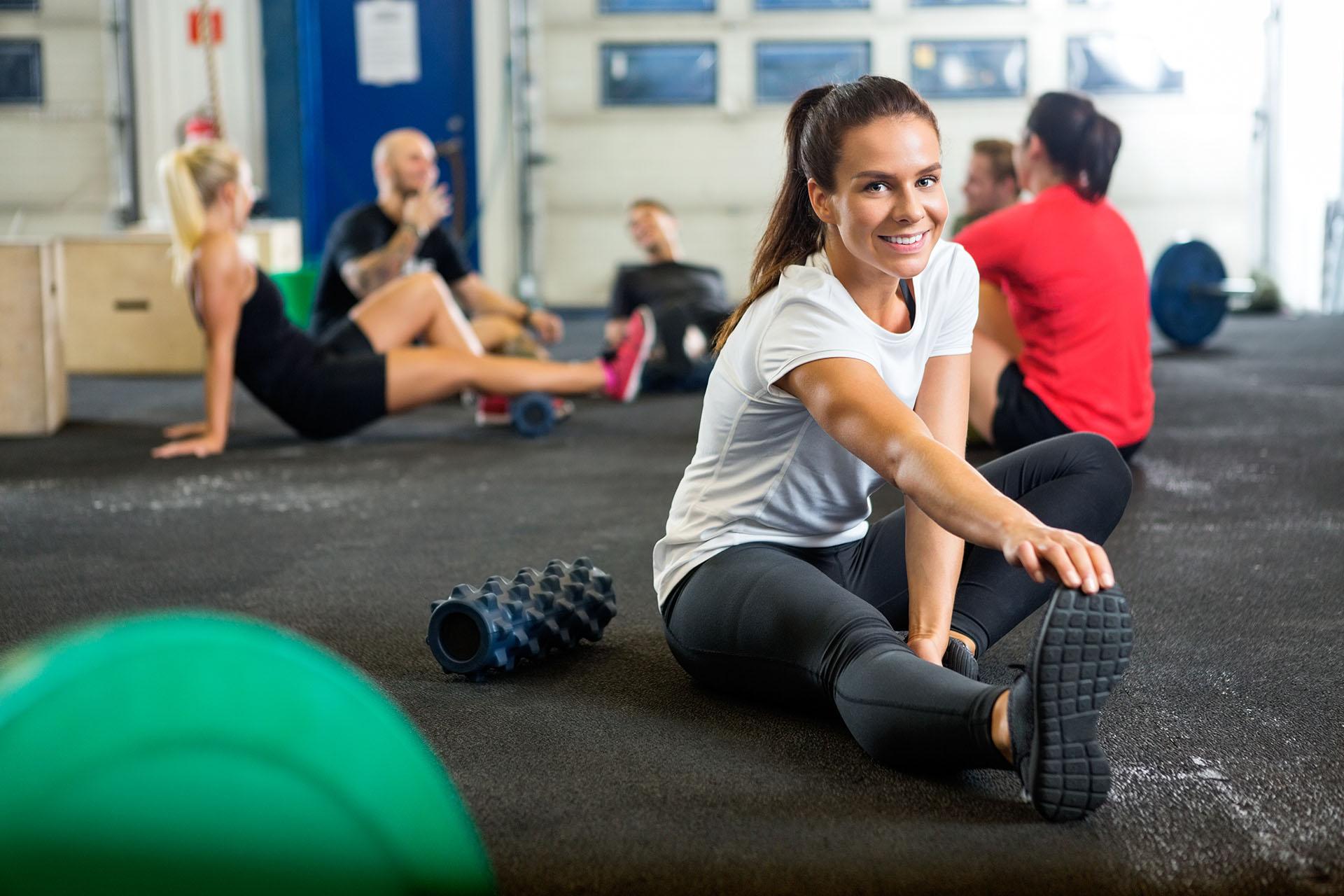 szkolenie AST Mobility, kobieta rozciągająca się